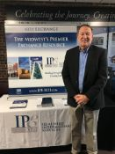 IPE representative at exhibitor booth